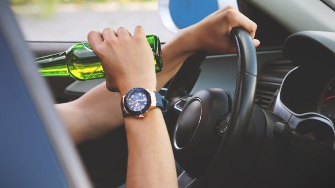 driving while holding a beer